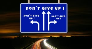 Don't Give Up Road Sign